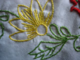 Genge, Eliza.  Close-up of embroidery done by Eliza Genge, Anchor Point.