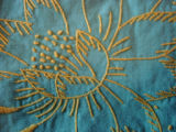 Dower, Alice.  Close-up of embroidered tablecloth made by Alice Dower, Conche, Newfoundland.