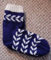Simmonds, Mary Jane.  A pair of blue flying goose pattern socks made by Mary Jane Simmonds,...