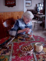 Simmonds, Mary Jane.  Mary Jane Simmonds serves tea and homemade partridge berry pie, Conche,...
