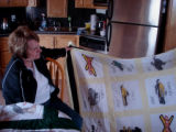 White, Eileen.  A painted snowmobile-themed quilt made by Eileen White, Sandy Cove.