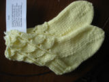 Genge, Eliza.  A pair of yellow baby socks made by Eliza Genge, Anchor Point.