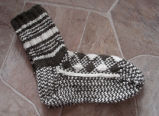 Simmonds, Mary Jane.  Traditional double-knit diamond pattern socks made by Mary Jane Simmonds,...
