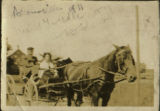Adamsville, horse and carriage. Black and white photograph.
