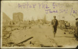 After the 1922 fire, with man walking. Black and white photograph.
