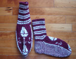 Kearney, Nellie.  Double-knit ship and anchor socks made by Nellie Kearney, Conche, Newfoundland.