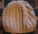 Dower, Alice.  A white winter hat made by Alice Dower, Conche, Newfoundland.