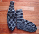 Kearney, Nellie.  Double-knit diamond patterned socks made by Nellie Kearney, Conche, Newfoundland.