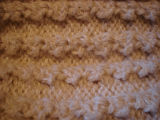 Dower, Alice.  Close-up of stitches from a white winter hat made by Alice Dower, Conche,...
