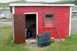 Bromley, Susan.  The 'old' wood shed in front of Susan Bromley's home, Conche, Newfoundland.