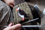 Kearney, Nellie.  Nellie Kearney's work-in-progress double knit puffin mittens, Conche,...
