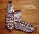 Kearney, Nellie.  Double-knit patterned socks made by Nellie Kearney, Conche, Newfoundland.
