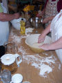 Bread Making Workshop.  Placing dough in bowls so that it can rise, Conche, Newfoundland.
