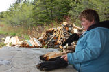 Bread Making Workshop.  Anne Byrne of the French Shore Historical Society removes bread from the...