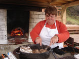 French Shore Interpretation Centre.  Anne Byrne prepares a roast in the outdoor oven at the French...