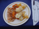 French Shore Interpretation Centre.  A salmon dinner prepared in the outdoor oven at the French...