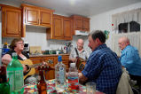 Casey House.  Local musicians play a kitchen party in the Casey House Artist Residency, Conche,...