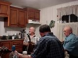 Casey House.  Conche musicians playing music in the Casey House Residency during a kitchen party,...