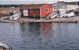 A sinking dock, Conche, Newfoundland.