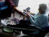Chambers, Laura.  Laura Chambers sitting and knitting in her chair, Flower's Cove.