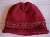 Chambers, Laura.  A red winter hat with a pattern, made by Laura Chambers, Flower's Cove.