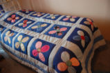 Carnell, Millie.  A flower pattern applique quilt made by Millie Carnell, Flower's Cove.