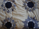 Chambers, Maggie.  A star pattern patchwork quilt made by Maggie Chambers, Flower's Cove.