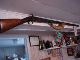 Carroll, Gertrude.  A gun that belonged to Gert Carroll's father in law, Conche, Newfoundland.