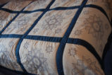 Carnell, Millie.  Embroidered star pattern quilt made by Millie Carnell, Flower's Cove.
