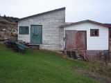 Hunt, Gertrude and Frank.  The stores behind the Gert and Frank Hunt's house, Conche, Newfoundland.