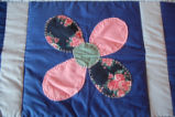 Carnell, Millie.  Close-up of a flower pattern applique quilt made by Millie Carnell, Flower's...