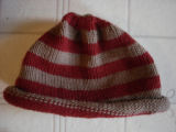 Chambers, Laura.  A striped red and brown winter hat made by Laura Chambers, Flower's Cove.