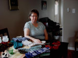 Hunt, Gertrude.  Gertrude Hunt poses with her knitting in her home, Conche, Newfoundland.