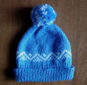 Carroll, Gertrude.  Blue zig zag pattern winter hat made by Gert Carroll, Conche, Newfoundland.