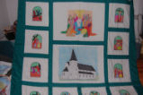 Burke, Odette and Pius.  A religious quilt featuring the 'Seal Skin Church' made by Odette and...