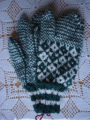 Rice, Betty.  A pair of green diamond pattern trigger finger gloves made by Betty Rice, Main Brook.