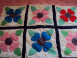 Elliott, Mary.  An applique flower quilt made by Mary Elliott, Main Brook.