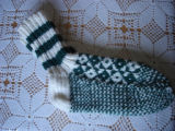 Rice, Betty.  A pair of green diamond pattern socks made by Betty Rice, Main Brook.