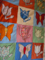 Elliott, Mary.  A colorful butterfly and flower quilt made by Mary Elliott, Main Brook.
