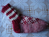 Rice, Betty.  A pair of red diamond pattern socks made by Betty Rice, Main Brook.