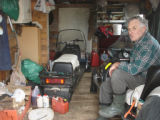 Rice, Norman.  Norman Rice poses for a photo in his shed, Main Brook.