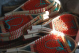 Elliott, George.  A pile of completed snowshoes made by George Elliott, Main Brook.