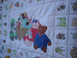 Coombs, Inga.  A painted baby quilt made by Inga Coombs, Main Brook.