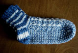 Carroll, Gertrude.  Traditional double-knit blue and white socks made by Gert Carroll, Conche,...