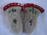 Coombs, Inga.  A pair sealskin mitten ornaments that belonging to Inga Coombs, Main Brook.