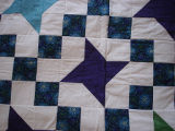 Elliott, Jaunita.  A patchwork star quilt made by Juanita Elliott, Main Brook.
