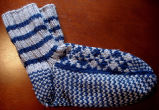 Hunt, Gertrude.  Traditional double-knit diamond pattern socks made by Gert Hunt, Conche,...
