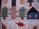 Elliott, Jaunita.  Close-up of a country themed quilt made by Juanita Elliott, Main Brook.