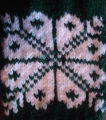 Dower, Alice.  Close-up of snowflake from double-knit gloves made by Alice Dower, Conche,...