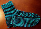 Hunt, Gertrude.  Traditional double-knit flying goose pattern socks made by Gert Hunt, Conche,...